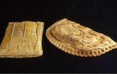 Two venison pasties made from seventeenth century designs. They are both over three feet long.