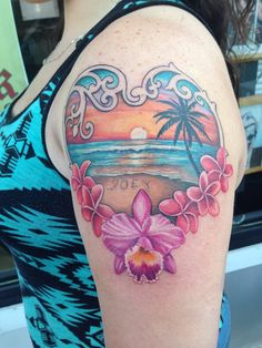 My tropical beach sunset tattoo with my sons name written in the sand
