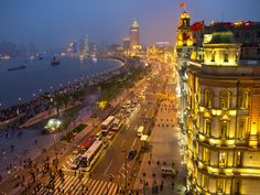 """""""blue hour on the bund"""", shanghai CN by tom horton on flickr. there are aspects of this (like the victorian architecture and the curve of the water along the skyline) that feel so familiar to me."""