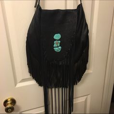 Leather Fringe Cross Body Purse 100% Leather.  Hand made  with beautiful blue rocks.  Bought this from a posher who said she would send me two bags and she didn't so i cant even look at this purse. She said she bought it from a small shop. That was a lie she got it off etsy. | not from listed brand just using for exposure | | no trades on this| Nasty Gal Bags Crossbody Bags