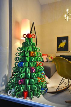 Great use of all the old mugs that are donated, could paint them for this mug tree, then it would be great in a holiday window display!