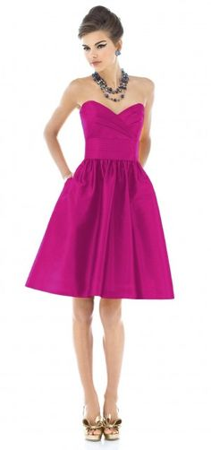 pink strapless bridesmaid dress and the flower choices are smashing. Love the pockets.