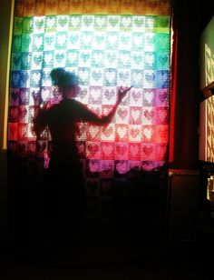 And that day, a crocheting genius was born. (Rainbow Hearts Filet Crochet Afghan / Curtain)