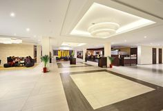 Hotel lobby by Geotech floor tiles: Duo Hotel in Prague