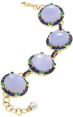Blue Chalcedony Emerald Sapphire Globe Bracelet, A One-of-a-kind, Icy cool and chic, Abellan New York's 18K solid yellow gold link bracelet features rare Blue Chalcedony stones (73.6 carats*) and a dazzling array of Blue Sapphires (4.35 carats*), rich Emeralds (1.44 carats*) and terminated with an Akoya Pearl. Handmade in New York City.