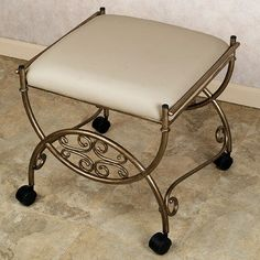 Vanity chairs for bathroom wheels. This one may be a bit too fancy, but a fabric covered vanity chair may be a nice addition in guest/office bath. Via NG interior design. Bathroom Vanity Chair, Vanity Seat, Floating Bathroom Vanities, Vanity Chairs, Bathroom Stools, Vanity Mirrors, Stool With Wheels, Kitchen Step Stool, Wrought Iron Decor