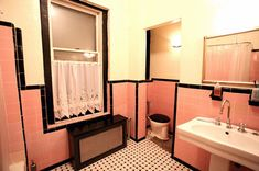 Pink with Black tile trim Art Deco style bathroom./ Don't love the pink but do like the overall style /