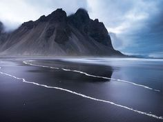 These are the best black sand beaches to escape to around the world, complete with moody vibes and photogenic aesthetics.