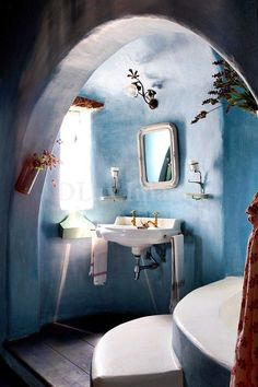 somehow I find this to be a sweet little bathroom. Like the sconces and fixture above the mirror.the tadelakt finish, and the color. Blue Bathrooms Designs, Design Bathroom, Bathroom Interior, Bathroom Ideas, Bathroom Inspiration, Mediterranean Bathroom, Tadelakt, Natural Homes, Natural Building