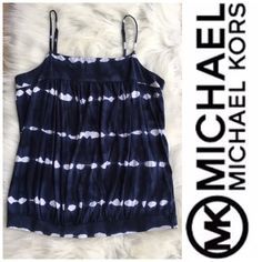 "Michael Kors Tie-Dye Tank Michael Kors pre-owned blue & white tie-dye tank top with spaghetti straps, size Large. Fits true to size. You can tell that it's pre-owned but it is in great condition other than normal wash-wear. Measures 17"" from underarm to underarm and 24"" from the top of the shoulder strap to the bottom hem. Let me know if you have any questions! Michael Kors Tops Tank Tops"
