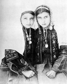 Old pictures of two young girls wearing their traditional Palestinian outfits