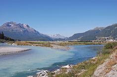 """""""Confluence,"""" by aivo2010, via Flickr -- Rough translation: At the small town of Bever, [Switzerland], the confluence of the Flaz River, at left, with its blue-whitish water originating in the Bernina mountains, and the blue-water Inn River, at right, without much glacial afflux. The Flaz appears to be the larger river, but hereafter, both become the Inn River."""