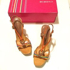 BCBGirls Multi-Colored High Heels, Size 6.5 Adorable and colorful high heels!  BCBGirls, Size 6.5.  Leather upper with T-strap design, with orange, brown, lime green, yellow, turquoise and hot pink leather straps.  Goes with everything.  Wood platform sole.  Only worn a few times, in great condition with minimal wear as shown in pics.  Heel height:  approx 3.5 inches  Comes with original box.   #bcbgirls #highheels #platform #stilletoheels #cuteshoes BCBGirls Shoes Heels