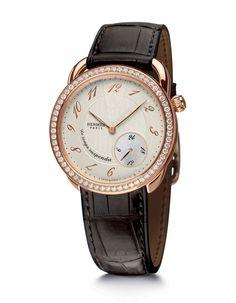 Montre Hermès Arceau Temps Suspendu vue à Bâle http://www.vogue.fr/joaillerie/news-joaillerie/diaporama/bale-horlogerie-baselworld-2013-montres-hermes-rolex-chopard-dior-harry-winston-omega-zenith-graff-ck/12954/image/748587#bale-horlogerie-baselworld-2013-montre-hermes-arceau-temps-suspendu