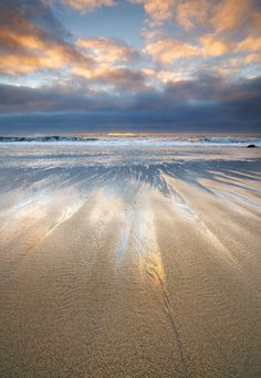 A blue and gold sunset at Hole in the Wall beach near Santa Cruz, California