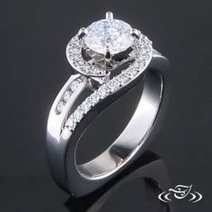 Beautiful custom Platinum wrap style 4-prong mounting with a Round Brilliant Cut diamond in the center, surrounded by a twist of prong set diamonds. European shank and polish finish. - See more at: http://www.greenlakejewelry.com/gallery/cust_gallery.aspx?ImageID=82554#sthash.gy7mLGIx.dpuf
