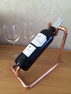 Copper pipe Wine bottle holder by CoppersmithsUK on Etsy $38.78