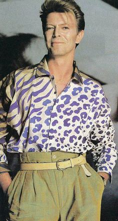 David Bowie Is... wearing a blouse.  And he still looks so manly. Good move, Iman.