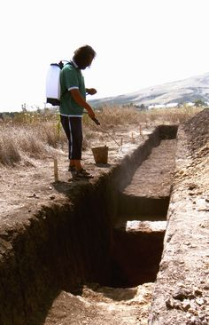 Day 10: Archaeologist Tibi Nica soaking the surfaces of pit 1 so to make it easier to work on the following day.