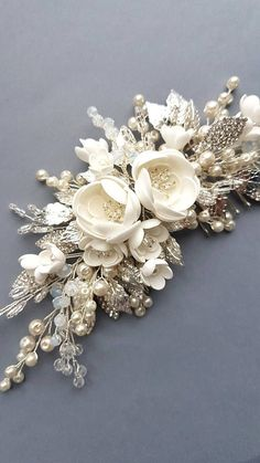 Pearl bridal hair comb wedding hair comb bridal headpiece wedding headpiece bridal hair piece wThis beautiful handmade bridal hair comb made with pretty crystal elements, handcrafted flowers and ivory glass pearls. Complement most wedding hairstyles. Bridal Headdress, Headpiece Wedding, Bridal Headpieces, Hair Comb Wedding, Wedding Hair Pieces, Handmade Wedding, Wedding Hair Accessories, Hair Jewelry, Fabric Flowers