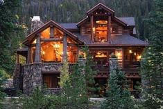 Gorgeous Montana log home with dark stain and native rock