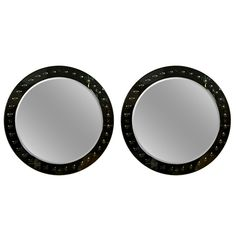 Pair of Decorative Round Glass Panel Mirrors | From a unique collection of antique and modern wall mirrors at http://www.1stdibs.com/furniture/mirrors/wall-mirrors/