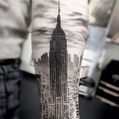 "15 Of The Craziest New York City-Inspired Tattoos #refinery29 http://www.refinery29.com/nyc-inspired-tattoos#slide-3 ""This client is creating a sleeve that marks important times in his life with the places he was during those moments; we've also done a big Golden Gate Bridge, and a nice beach scene where he proposed to his wife,"" artist Matt Mrowka says of this grey-scale ink. ""There's more to do on this arm, and I'm looking forward to bringing the whole composition together."""