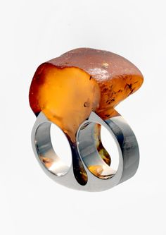 Jānis Vilks' jewellery is monumental, laconic in form and seeks to reveal the uniqueness of materials. All of these characteristics are present in his amber jewellery collection, which has preserved the natural form and texture of this gem born of resin. The artist has intervened only so much as to adapt the material to human anatomy. Vilks has also used mammoth tusk – another material with a similar place and manner of origin as amber and that likewise evokes the ancient world.