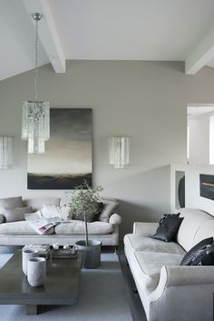 Squishy sofas teamed with a contemporary grey colour palette – we love! Image: Livingetc