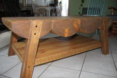 Montana-made coffee table, Brett Burglund - designer and creator. Made from construction project scraps: rough-saw logs, tongue-and-groove shelf, walnut pegs. Absolutely stunning!