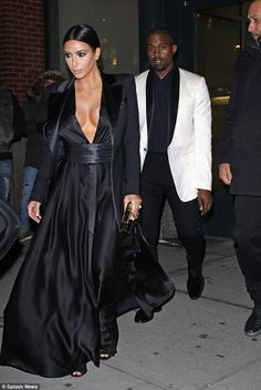 Formal look: Her chic flowing frock went down to the floor and was teamed with a pair of strappy open toe stiletto heels and a small square clutch