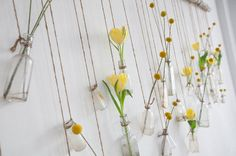 I saw an awesome home decor idea in someone's house last night, and this photo is the closest I can get to recreating it. Take a long, sturdy branch or piece of bamboo, and hang it horizontally on a wall. Tie long, vertical pieces of twine from the branch. Use short pieces knotted together for a more rustic effect. Use mini clothespins to hang cards, photos, or (in my opinion), attractive silk flower branches across the wall. You can swap out the decorations based on the season or holiday.