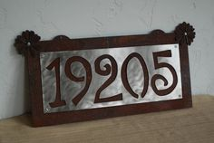 House Numbers Sign - Rusted Steel - Stainless Steel - Up to 5 numbers. $65.00, via Etsy.