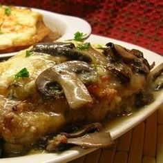 Try this winning combination of baked chicken breasts, mozzarella, and mushrooms. Serve with hot cooked rice or noodles.