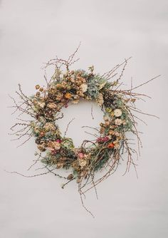 A willow wreath base is a beautiful canvas for delicate dried flowers. Wild and natural with pops of festive colour, it's a change from the traditiona. Dried Flower Wreaths, Dried Flowers, Autumn Wreaths, Holiday Wreaths, Holiday Decor, Christmas Door Wreaths, Willow Wreath, Christmas Flowers, Christmas Trends