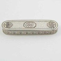 A George III bright-engraved toothpick box, with rounded ends and pricked decoration around the sides, initialled, by Samuel Pemberton, Birmingham 1796, 2.75in (7cm) long.  Estimate: £250-300  Hammer Price: £600  Lot: 524  Sale: Silver (SV280109)