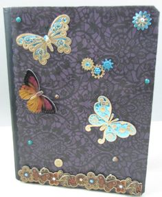 Bound journal with lined paper, purple with abstract black floral design and butterfly embellishments..
