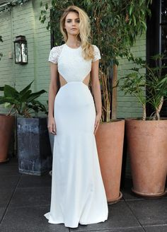 Sarah Seven wedding dress with lace bodice and short sleeves, cutout waistline and white skirt Fall 2016