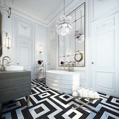 Luxury and Modern Black and White Bathroom Idea | Bold lines and high contrast inform this white bathroom. Faded gold metals sprinkle throughout the stark white space with black tile patterns on the floor. ➤To see more Luxury Bathroom ideas visit us at www.luxurybathrooms.eu #luxurybathrooms #homedecorideas #bathroomideas @BathroomsLuxury