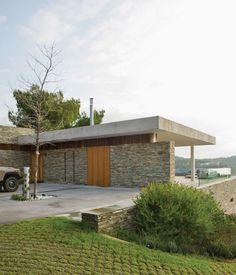 This modern home with jaw-dropping views on the Aegean island of Skiathosusesdry-stacked slate quarried from a nearby island as a nod to its location.