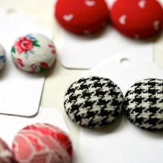 A tutorial on how to make earrings out of fabric buttons.