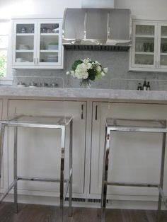 marble + glass + vent hood and stools that look cool but might be a little more comfortable than these.