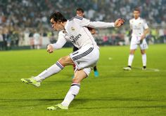 Gareth Bale of Real Madrid strikes at goal during the Dubai Football Challenge match between AC Milan and Real Madrid at The Sevens Stadium on December 30, 2014 in Dubai, United Arab Emirates.