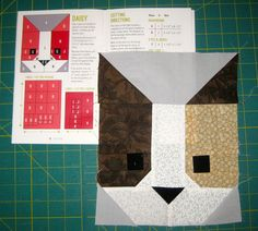 For Christmas I received Elizabeth Hartman's quilt pattern The Kittens. I usually improv when quilting, I like the spontaneity of just picking a pieces of fabric and sewing them together. But this pattern was so cute I really wanted to try it. There are 6 different cat faces to make in this pattern & cutting out the small pieces was kind of a pain. Once I got going it was very easy to make these 8 1/2 x10 1/2 squares.