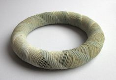 Necklace | Nel Linssen.  Reinforced paper with elastic thread.