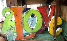 Vintage Colorful Metal Accent Signs | A behind the scenes look at our inventory by Neilsen-Hall Photography.  *Paisley & Jade...Vintage & Eclectic Furniture Rentals for Events, Weddings, Theatrical Productions & Photo Shoots*