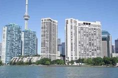 Considering buying a condo or loft in Toronto? Explore some of Toronto's best condos and lofts, which our real estate team love being associated with. Seattle Skyline, New York Skyline, Buying A Condo, Us Real Estate, Condos For Sale, Real Estate Marketing, Cn Tower, San Francisco Skyline, Ontario