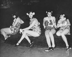 """Luau girls - resting on the set of Ray Enright's film, """"Golddiggers in Paris,"""" 1938"""