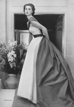 Suzy Parker wearing a gown by Christian Dior for Vogue, April 1952.