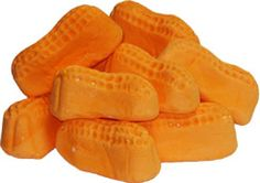 circus peanuts. Whenever we were at the grocery store my mom would always check the circus peanuts. If they were soft she would buy them and we would eat them on the way home!